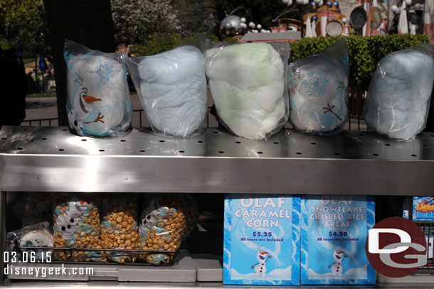 Olaf treats at a cart on Main Street USA near the Photo Store/Corn Dog Truck