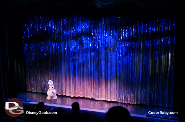 Olaf dances on stage to introduce Frozen Fever