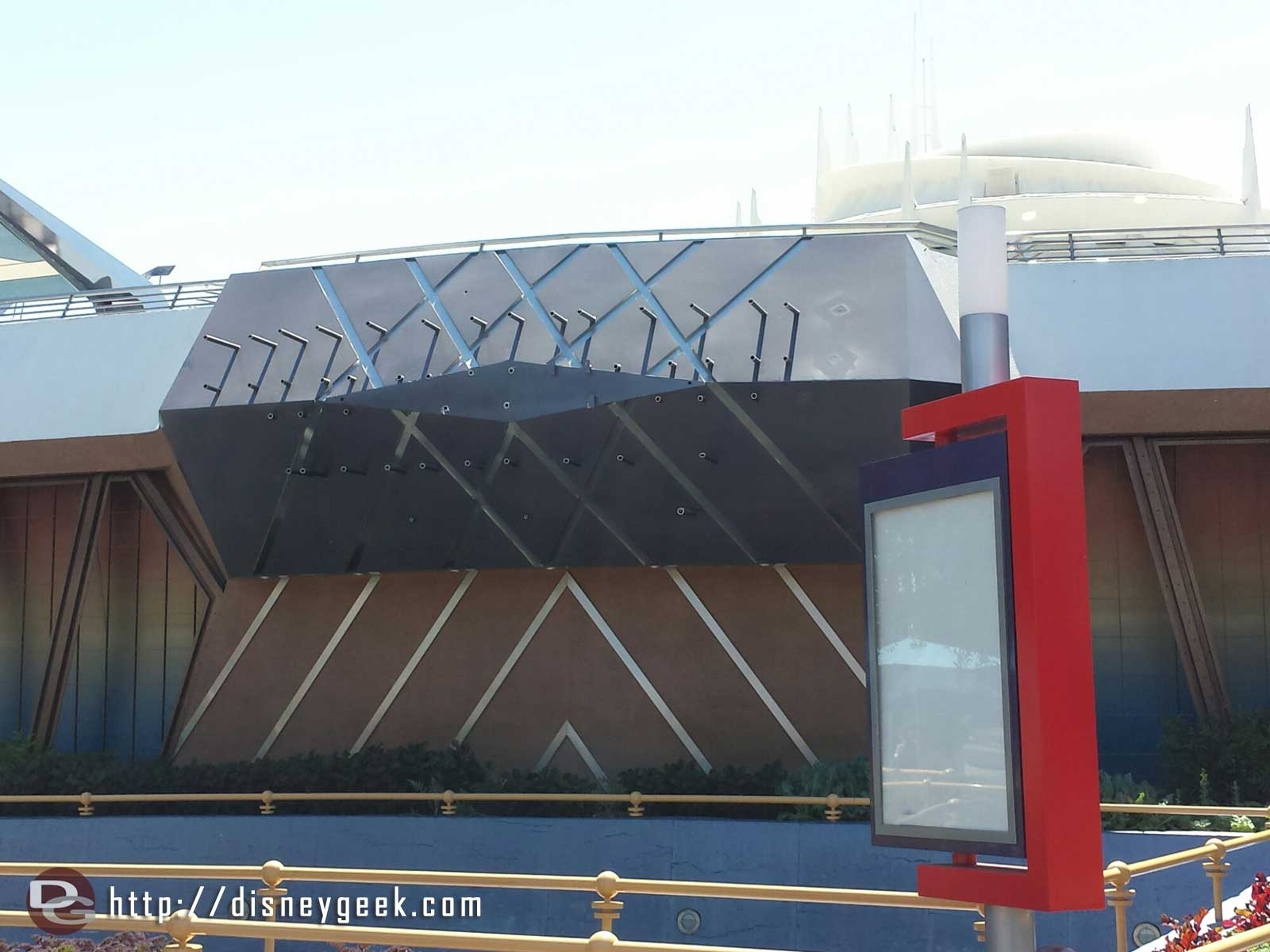In Tomorrowland the #BigHero6 signage is removed.  A preview of the upcoming Tomorrowland film starts in April
