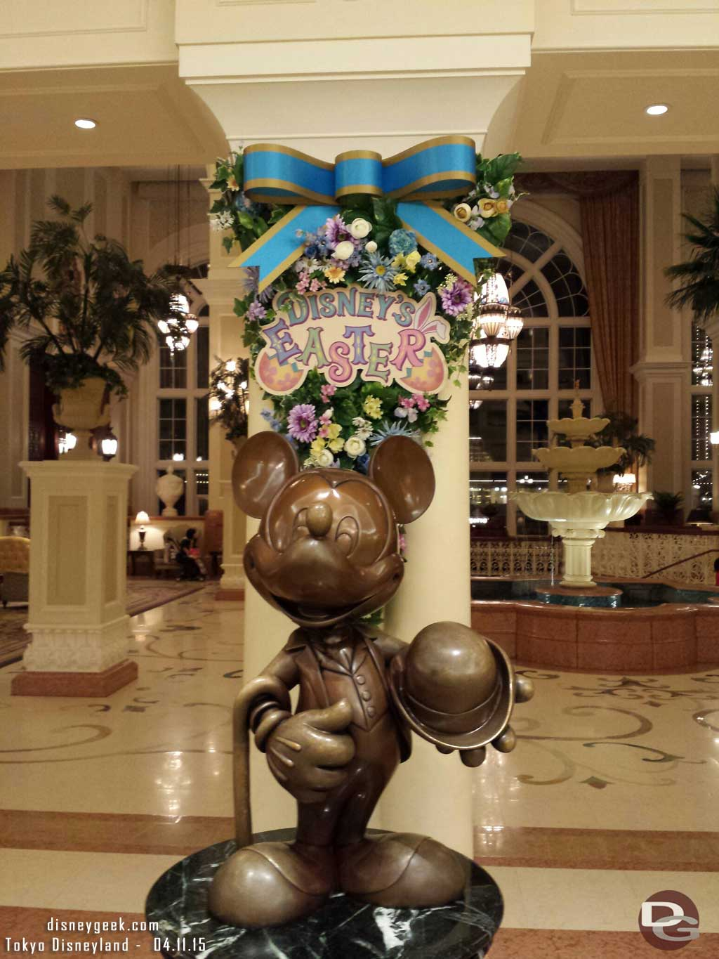 Mickey statue on the #TokyoDisneylandHotel with an Easter sign