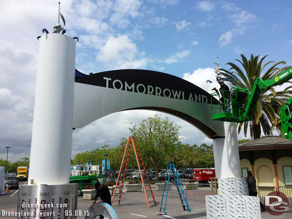 The blue entrance sign by ESPN is being covered for the Tomorrowland premiere