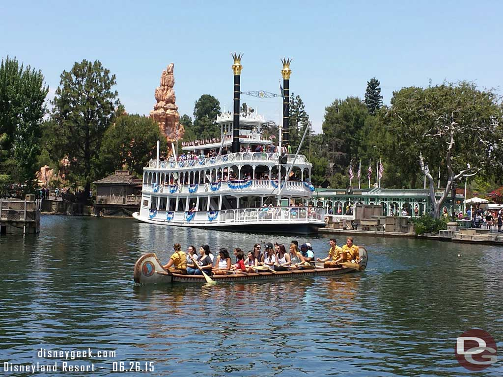 A canoe passing by as the Mark Twain readies to leave port on the Rivers of America #Disneyland