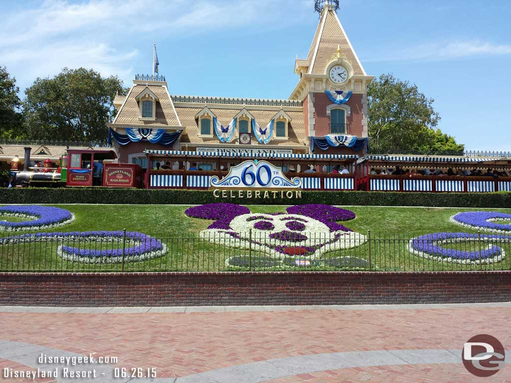 The Ward Kimball passing by the #Disneyland60 entrance display