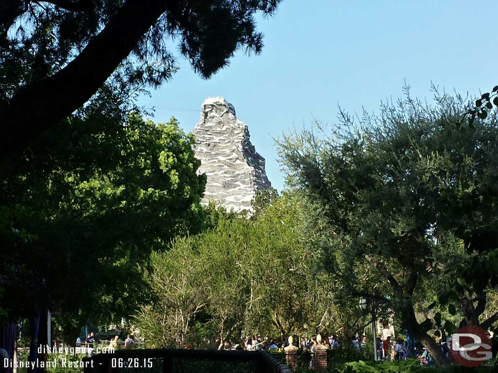 Matterhorn through the trees from a quiet spot off the hub #Disneyland