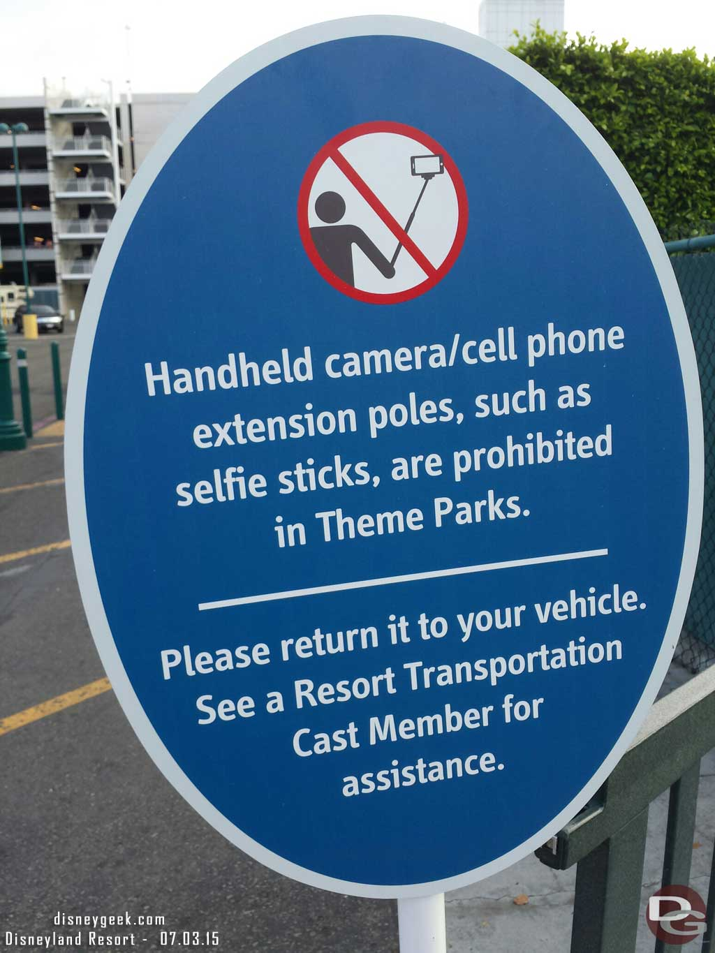 Arriving at #Disneyland signs about the selfie stick ban at the tram stop