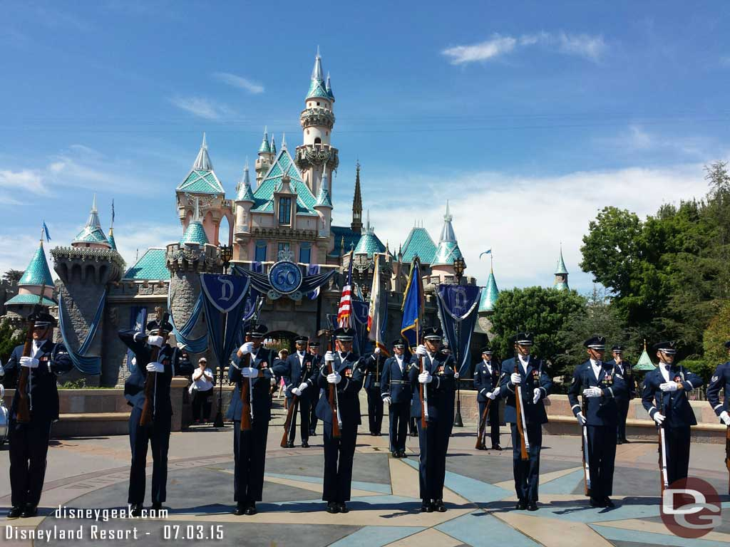 United States Air Force Honor Guard performing in front of Sleeping Beauty Castle