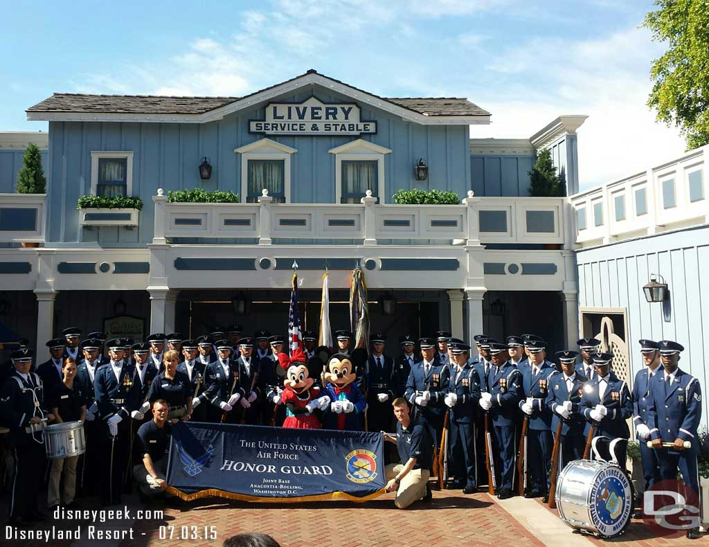 United States Air Force Honor Guard posing with Mickey and Minnie for a photo