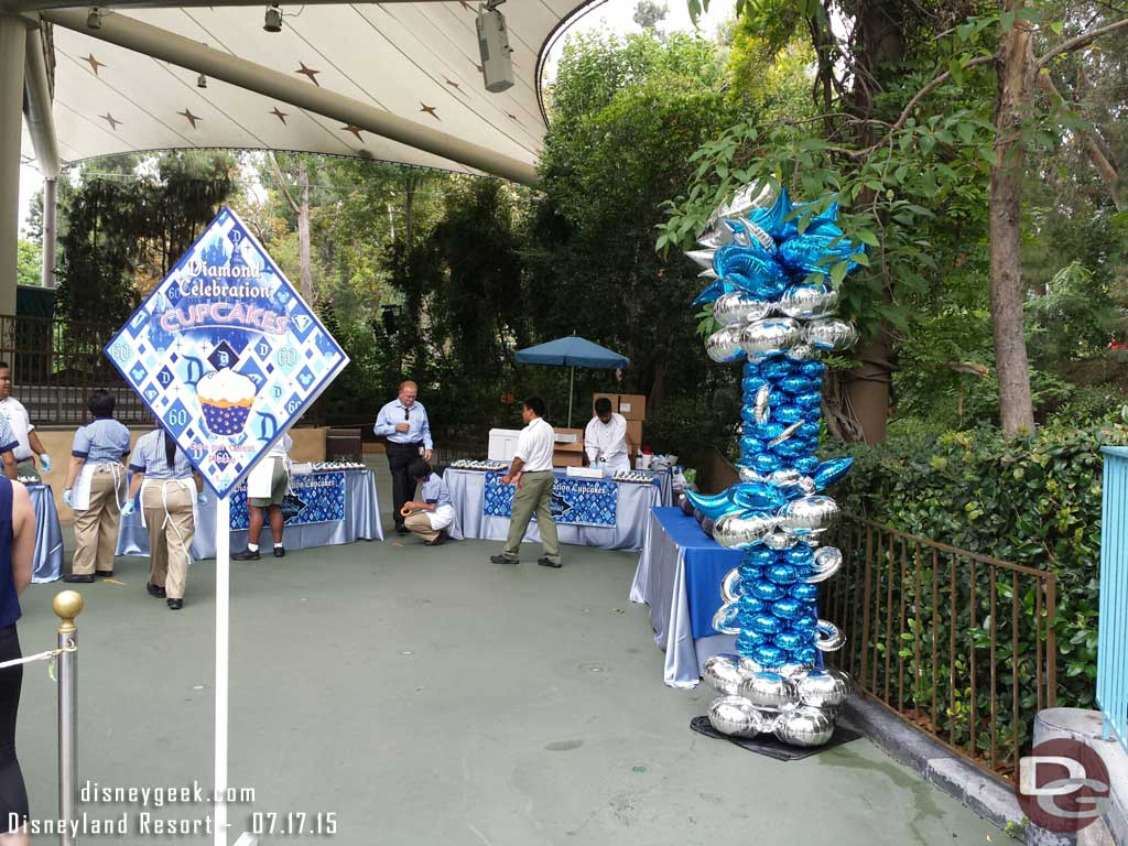 Preparing for #Disneyland60 cupcake distribution in Fantasyland only a dozen guests in line here