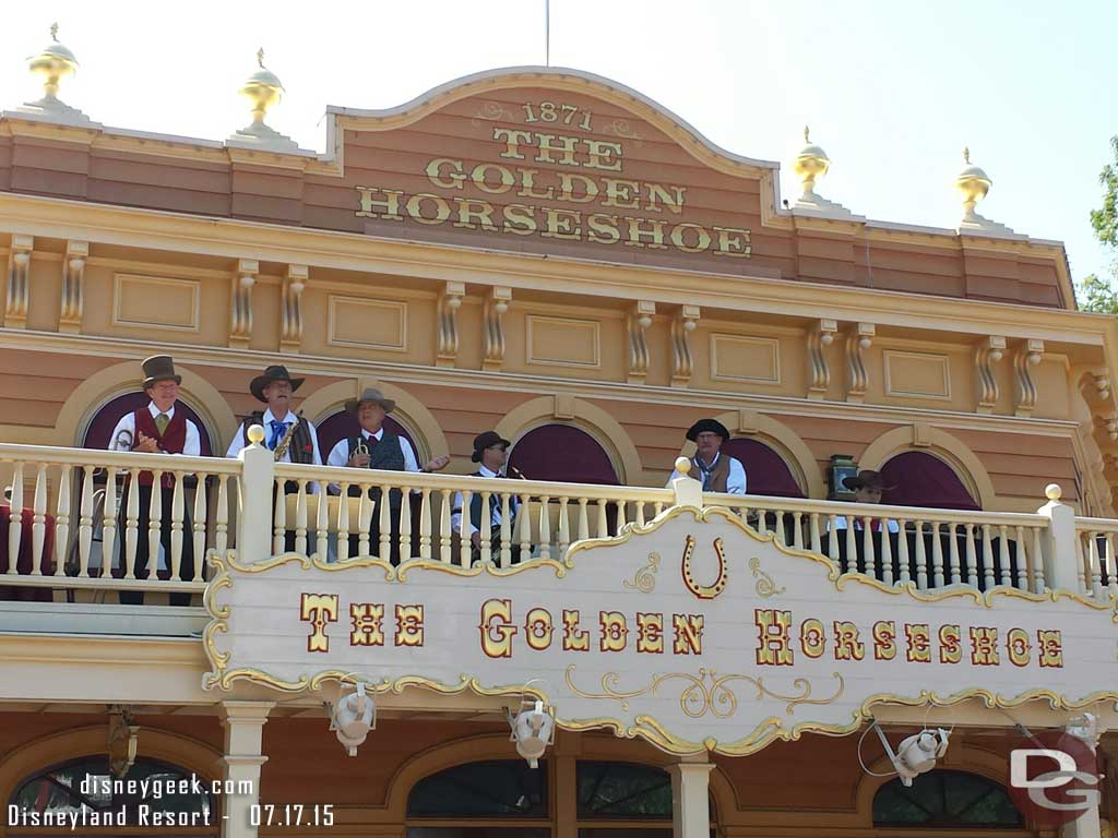 A band performing on the Golden Horseshoe balcony #Disneyland60