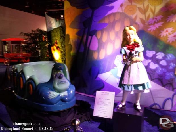 Alice in Wonderland figure and vehicle - Walt Disney Archives Presents - Disneyland: The Exhibit