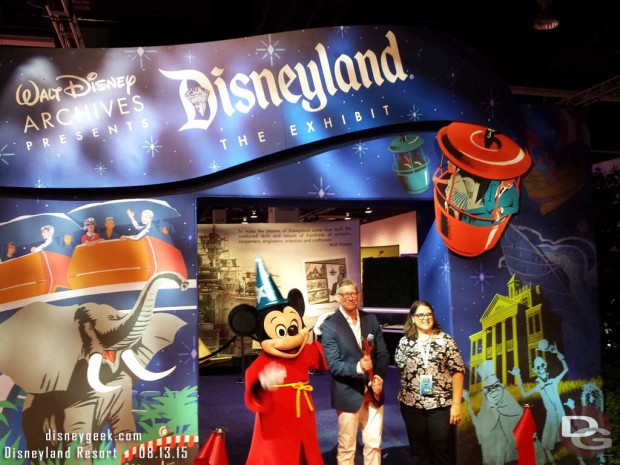 Mickey Mouse, Adam Sanderson and Becky Cline cut the ribbon to open the Walt Disney Archives Presents - Disneyland: The Exhibit
