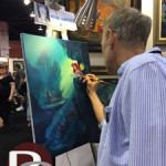 Disney Artist, Michael Humphries, paints a scene from The Little Mermaid.