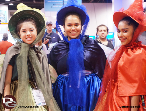 These cosplayers dressed as Flora, Fauna and Merryweather (aka the Three Good Fairies) are the Good Fairy Godmothers from Sleeping Beauty
