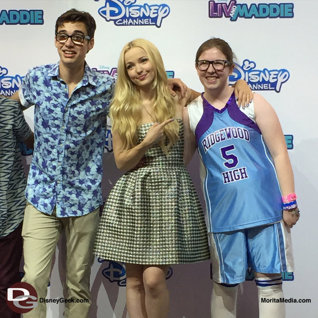 The Liv and Maddie Cast Take a Photo with a big fan of the show! She even got the whole Maddie Rooney outfit down.