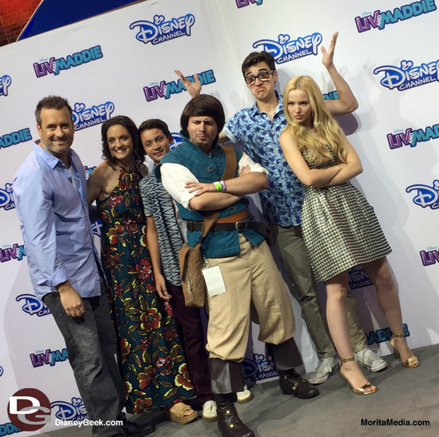 Wait for the smolder... Flynn Ryder takes a photo with the cast of Liv and Maddie