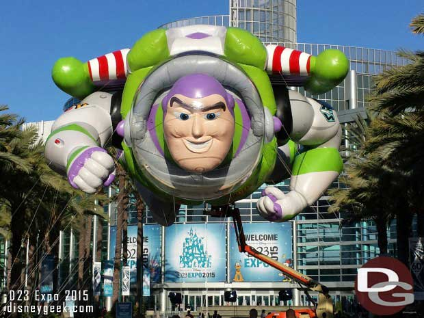 Buzz Lightyear greets you as you arrive