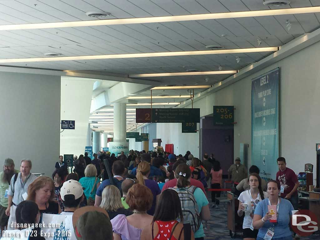 The trading card line stretches a long way, it goes down toward room 208 and around the corner #D23Expo