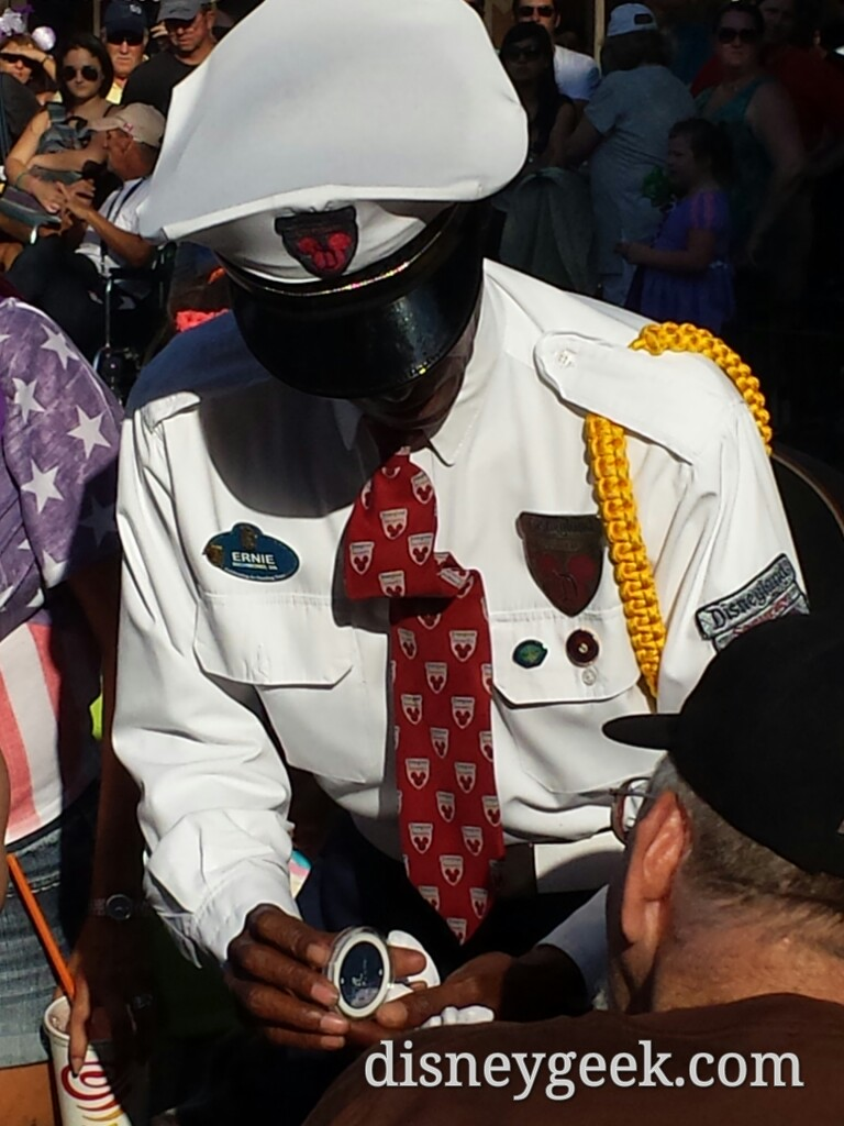 #Disneyland security cast member, Ernie, presenting a challenge coin to a veteran before today's flag retreat