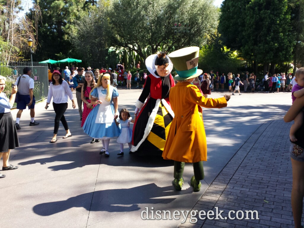 Alice, Queen of Hearts & Mad Hatter out for a walk.  Notice Peter Pan & Hook in the background #Disneyland