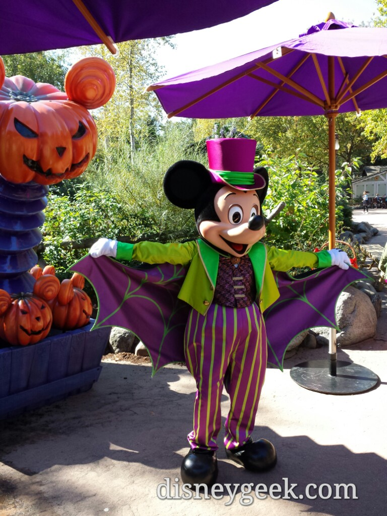 Mickey Mouse showing off his Halloween Costume in Frontierland