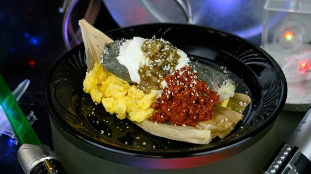 Blue corn Darth Tamale, with scrambled eggs and chorizo, red chili sauce and tomatillo