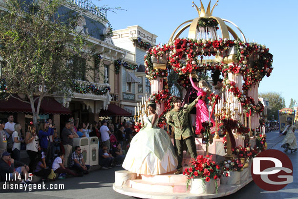 Princess Tiana on the front of the float with other Disney Princesses and Princes