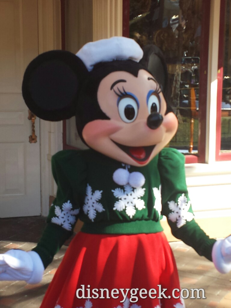Minnie in her holiday outfit on Main Street USA #Disneyland