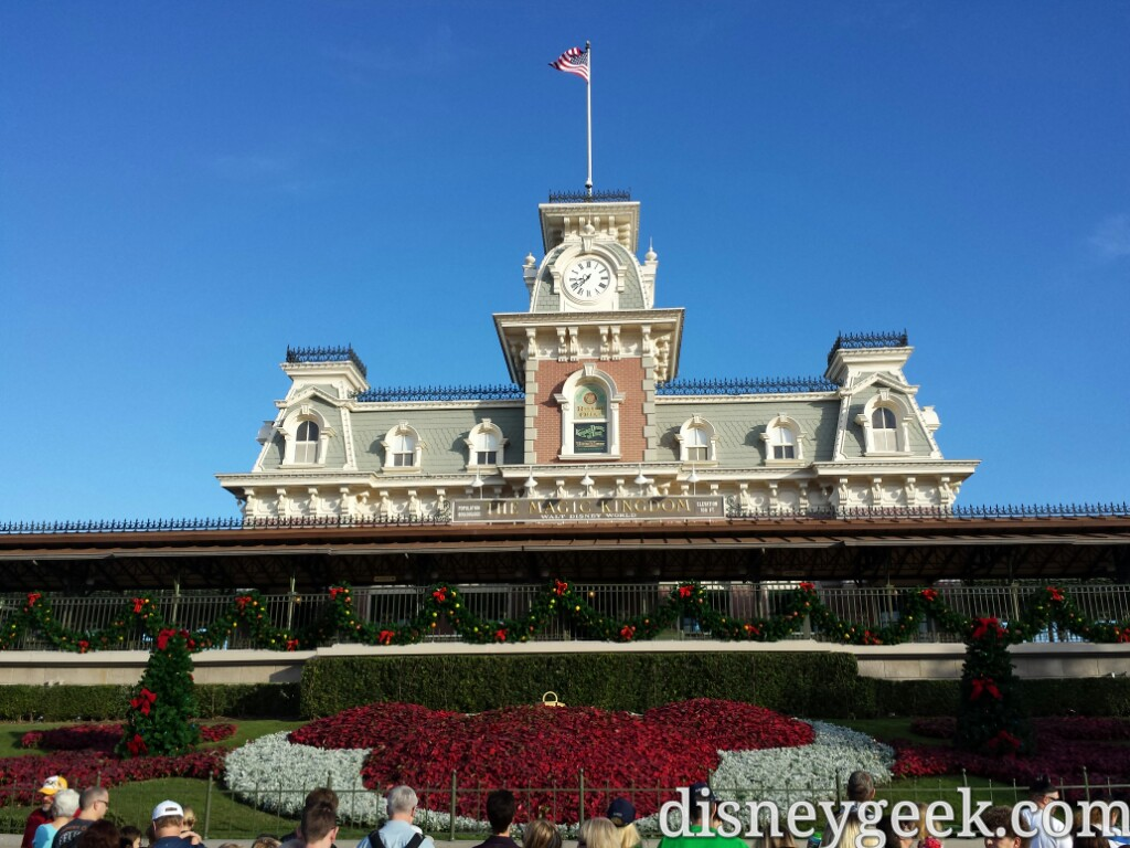 Magic Kingdom Main Street train station & floral Mickey #DisneyHolidays #WDW