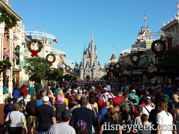 The opening crowd heading up Main Street and into the park.