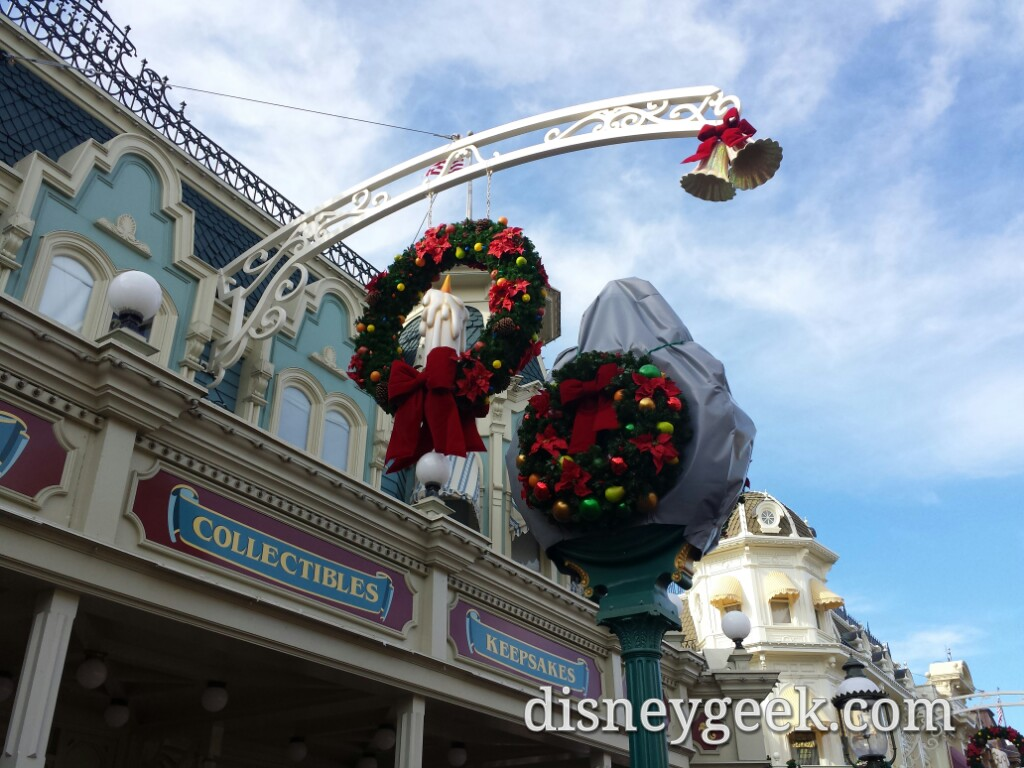 The clock on Main Street USA is covered and had wreaths on it #WDW
