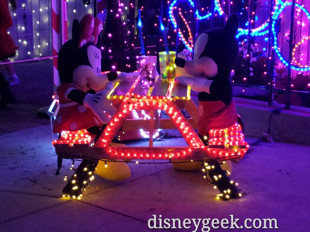 Mickey & Minnie having a picnic with #Frozen mugs in the Osborne Lights at Disney's Hollywood Studios