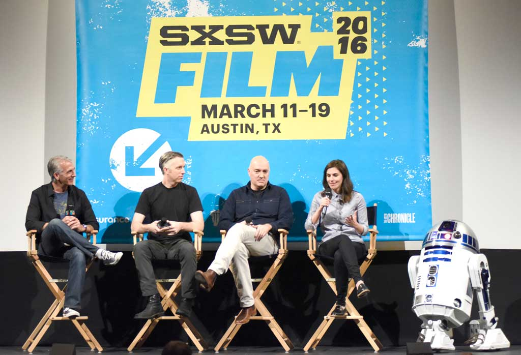 AUSTIN, TX - MARCH 14:  Moderator Scott Mantz, Supervising Sound Editor Matt Wood, VFX Supervisor Roger Guyett, co-producer Michelle Rejwan and R2D2 speak during the Q&A after a screening of Star Wars: The Force Awakens: A Cinematic Journey on March 14, 2016 in Austin, Texas.  (Photo by Vivien Killilea/Getty Images for Walt Disney Studios Home Entertainment) *** Local Caption *** Scott Mantz; Matt Wood; Roger Guyett; Michelle Rejwan; R2D2