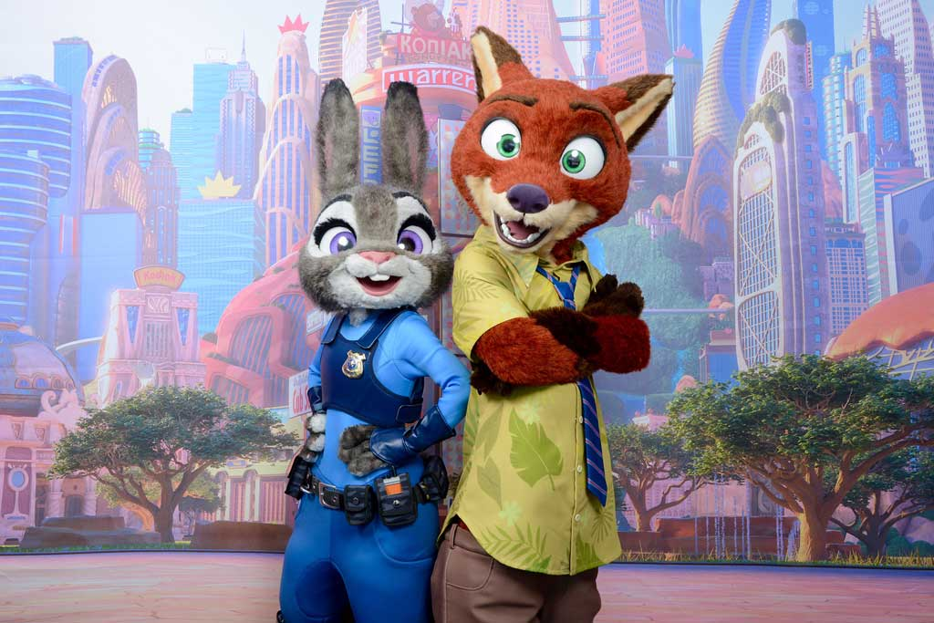 """Beginning this spring, Nick Wilde and Judy Hopps from Walt Disney Animation Studios' """"Zootopia"""" will be visiting Disneyland Resort, where guests can find them on Hollywood Boulevard at Disney California Adventure park and at Magic Kingdom Park at Walt Disney World Resort during the """"Move It! Shake It! Dance & Play It!"""" Street Party at Magic Kingdom Park. """"Zootopia"""" opens in theaters in 3D on March 4. (Disney)"""