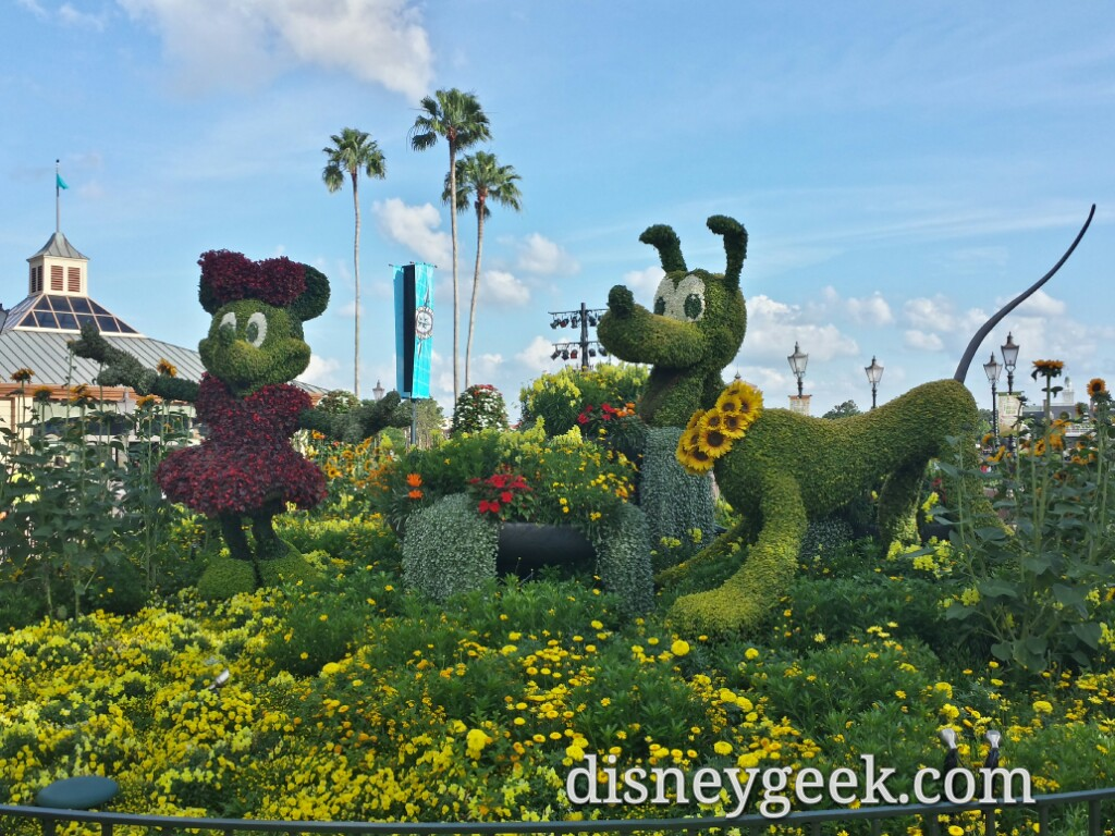 Minnie & Pluto Topiaries at the entrance to World Showcase in Epcot for the International Flower and Garden Festival