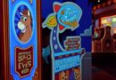 Toy Story Midway Mania – Woody's Roundup & Pizza Planet signs