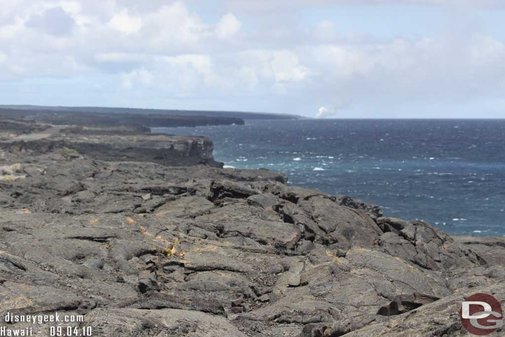 Volcanoes National Park - In the distance an active lava flow entering the ocean (where the steam is)