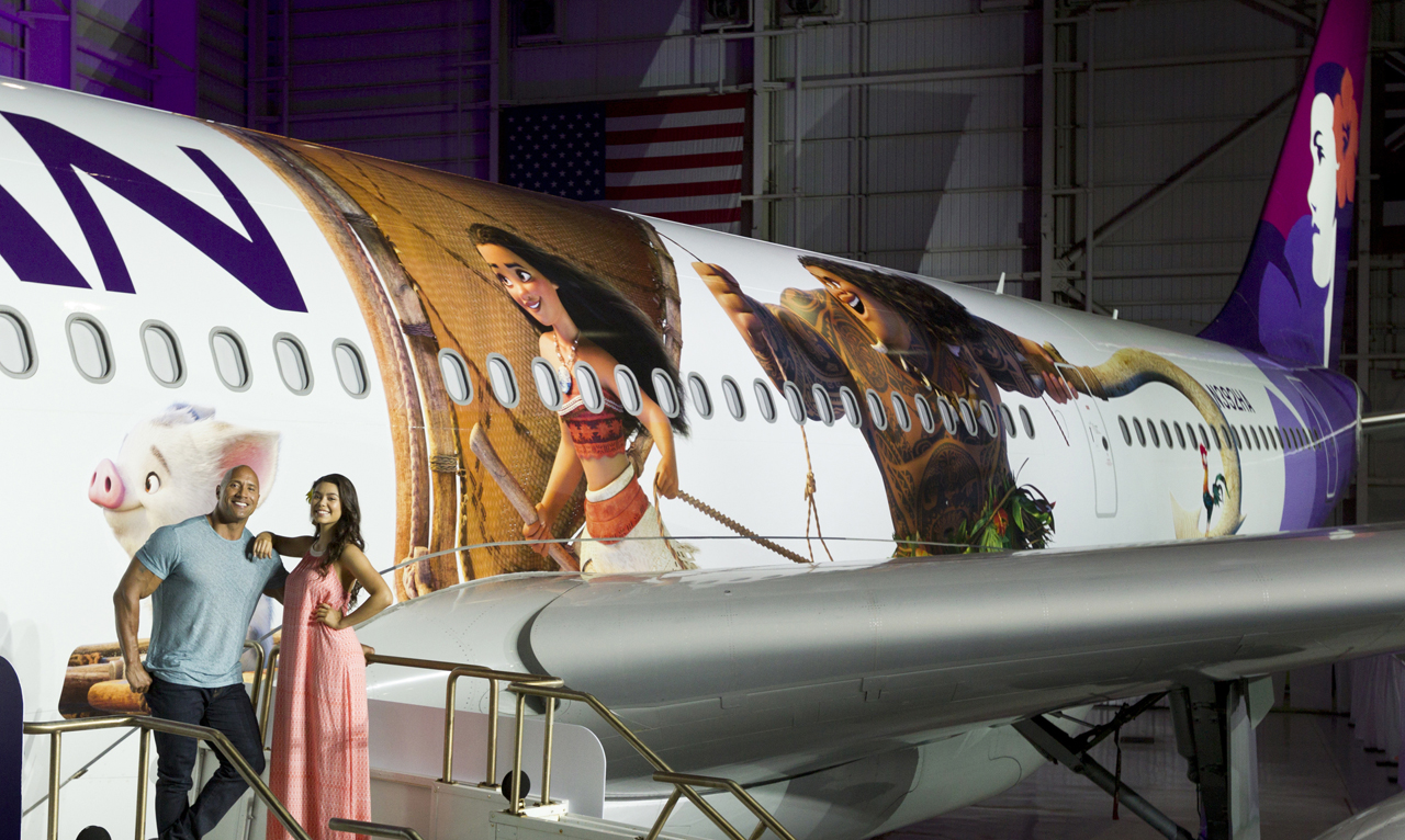 """Hawaiian Airlines today revealed the first of three """"Moana""""-themed planes at its home base at Honolulu International Airport (HNL). Auli'i Cravalho, the Hawai?i-born actress who is the voice of Disney's """"Moana,"""" and Dwayne Johnson, the voice of demigod Maui, were among the first to see the inspiring new design. Photo by Donald Traill for Hawaiian Airlines"""