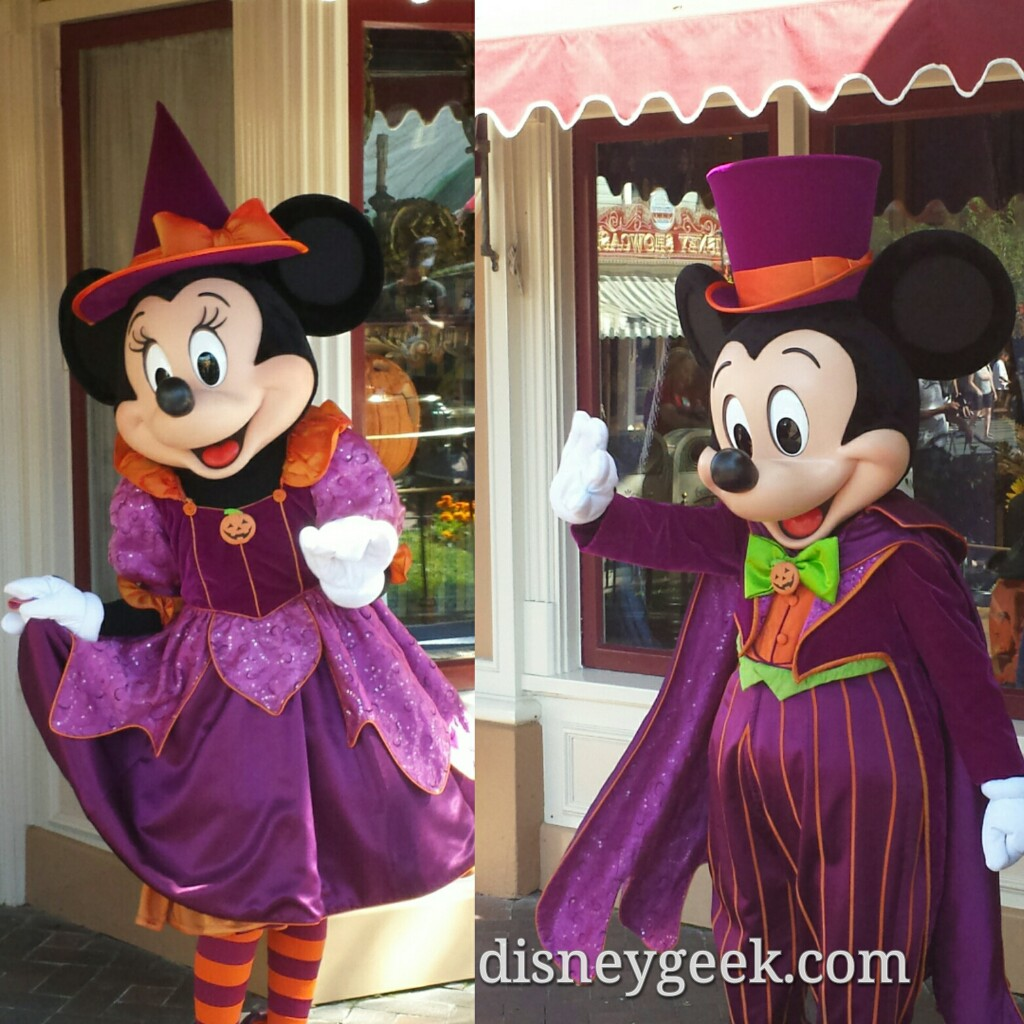 minnie mickey mouse wearing halloween costumes in town square disneyland