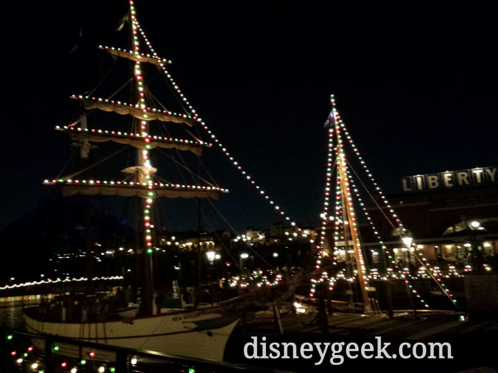 Tokyo DisneySea - Boats in the New York Harbor featuring Christmas lights.