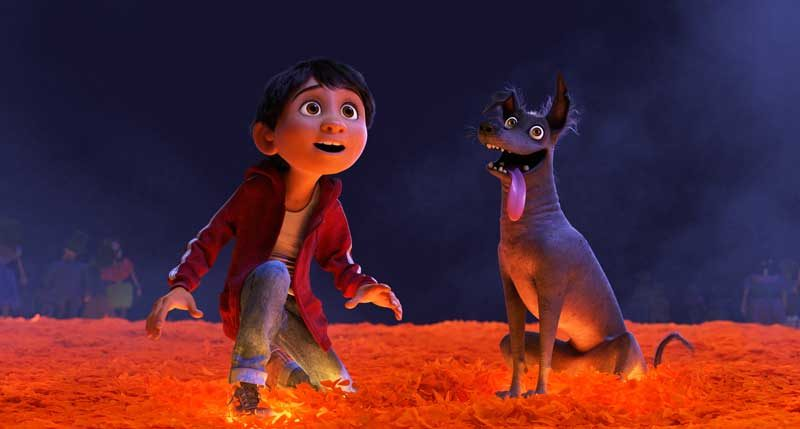"""MARIGOLD BRIDGE — In Disney•Pixar's """"Coco,"""" Miguel (voice of newcomer Anthony Gonzalez) desperately wants to prove his musical talent. But when he strums the guitar of his idol, the late Ernesto de la Cruz, Miguel sets off a mysterious chain of events and finds himself—and his loyal dog Dante—crossing into the Land of the Dead via a breathtaking bridge made of marigold petals. Directed by Lee Unkrich, co-directed by Adrian Molina and produced by Darla K. Anderson, """"Coco"""" opens in theaters Nov. 22, 2017. ©2017 Disney•Pixar. All Rights Reserved."""
