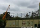 Steel for Splitsville rising above the wall in Downtown Disney