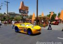 Cruz Ramirez passing the Cozy Cone on Route 66 in Cars Land