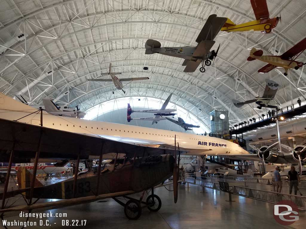 The hangar had planes suspended at different heights plus on the ground.