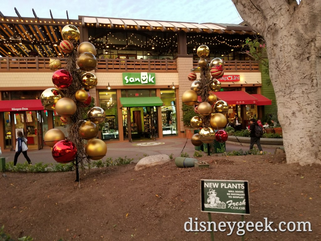 downtown disney christmas decoration installations several pics