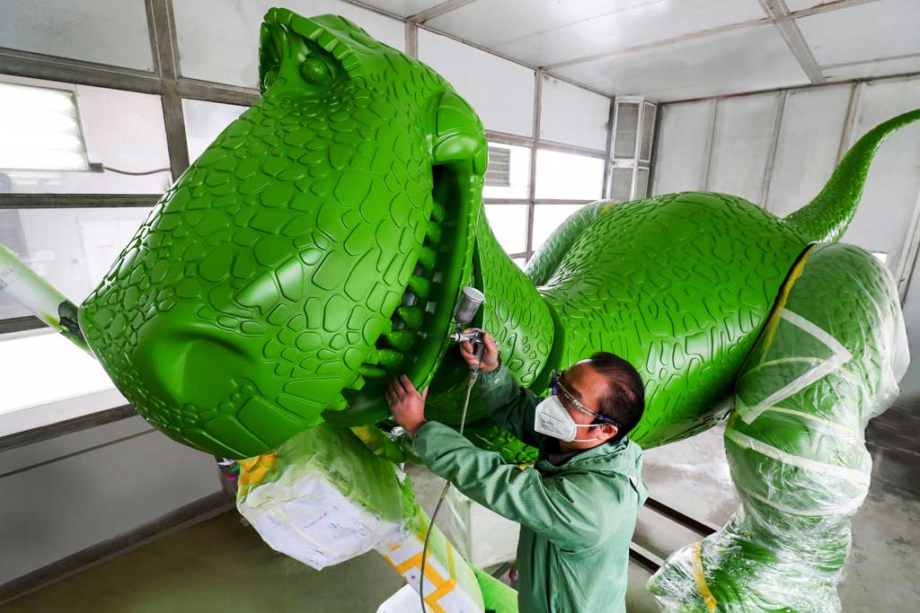Disney Imagineers and construction teams are painting Rex in Shanghai Disney Resort's Show Production Center, where over 400 toys for the new land are being produced.