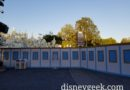 Walls up around the small world mall and attraction for removal of the holiday overlay and a reconfiguration of the parade route