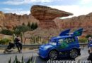 DJ Rolling by on Cross Street in Cars Land