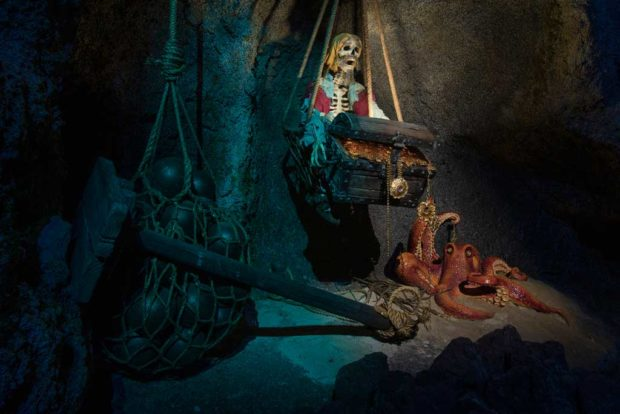 PIRATES OF THE CARIBBEAN ADDS NEW MAGIC (Anaheim, Calif.) – The original Pirates of the Caribbean attraction at Disneyland park, which inspired a global phenomenon and launched a highly popular film franchise, adds new magic in 2018 with a new scene. Fans from the attraction's early days may hear a familiar voice as a pirate shares the cautionary tale of a cursed treasure as they pass a swashbuckler caught in a booby-trap. (Joshua Sudock/Disneyland Resort)