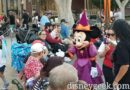 Minnie Mouse in her Halloween attire visiting with guests in Town Square