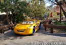 Cruz Ramirez parked near Ramones on Cross Street in Cars Land